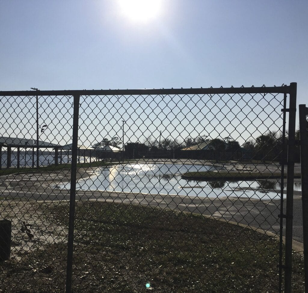 Water stands in part of the parking lot at Shoreline Park south. Many boaters were disappointed that the boat ramp opened only to Gulf Breeze residents last week, but it is scheduled to open to the general public on Saturday. Glenda Caudle | Gulf Breeze News