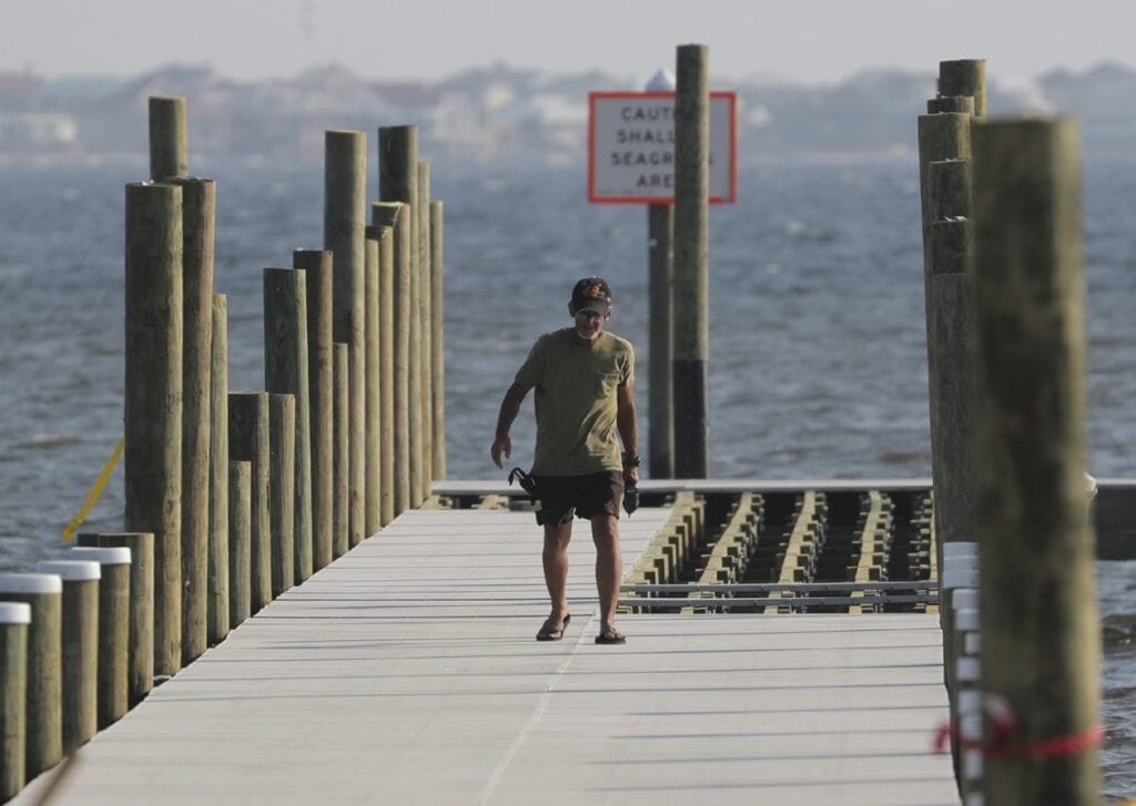 A worker walks on the Oriole Beach boat ramp pier, which underwent scheduled maintenance before Hurricane Sally hit. The boat ramp is scheduled to be back in service soon, according to County Commissioner Lane Lynchard. Photos by Jason Thompson | Gulf Breeze News