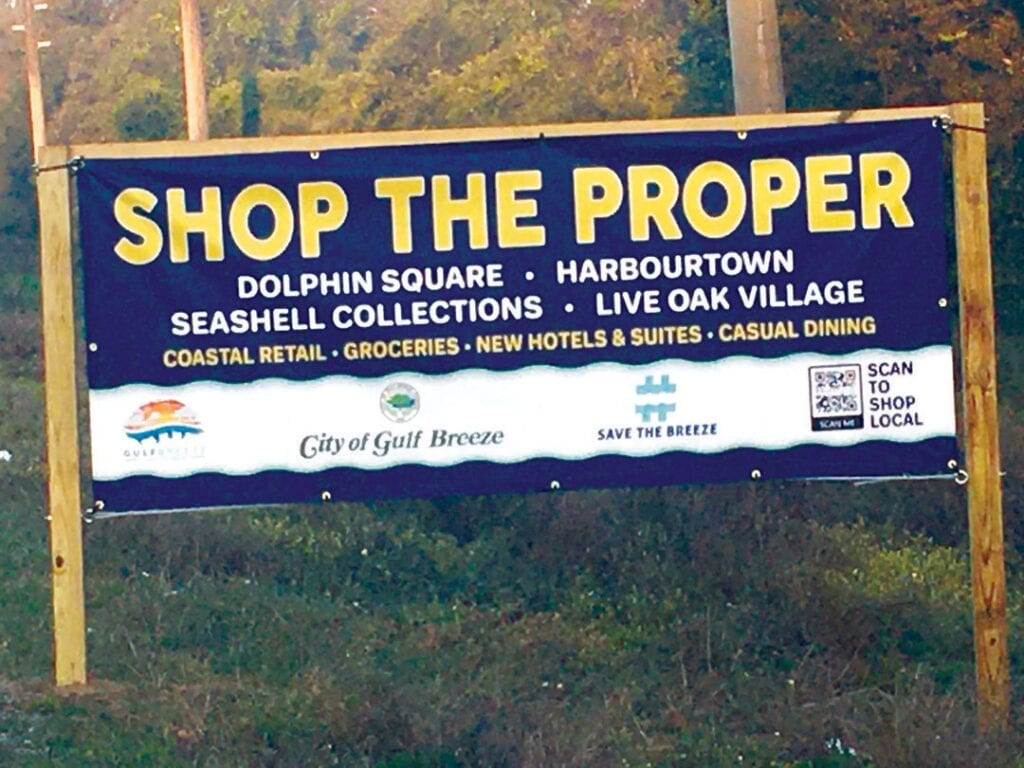 Signs point drivers to shop local