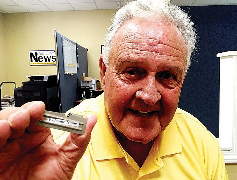 Chris Lambert holds Vietnam-era can opener with a