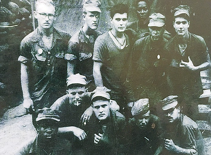 Lambert (kneeling, center) poses with some of his fellow Marines from Alpha Company A15 while in Vietnam.